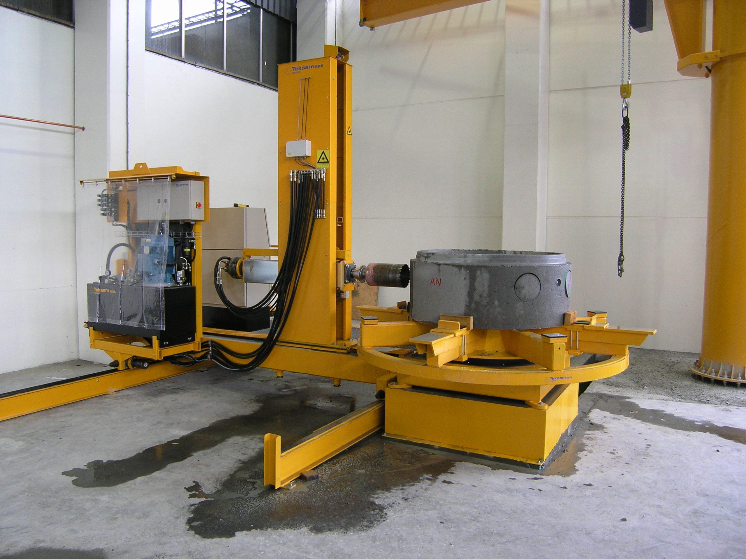 Concrete coring machine drilling holes